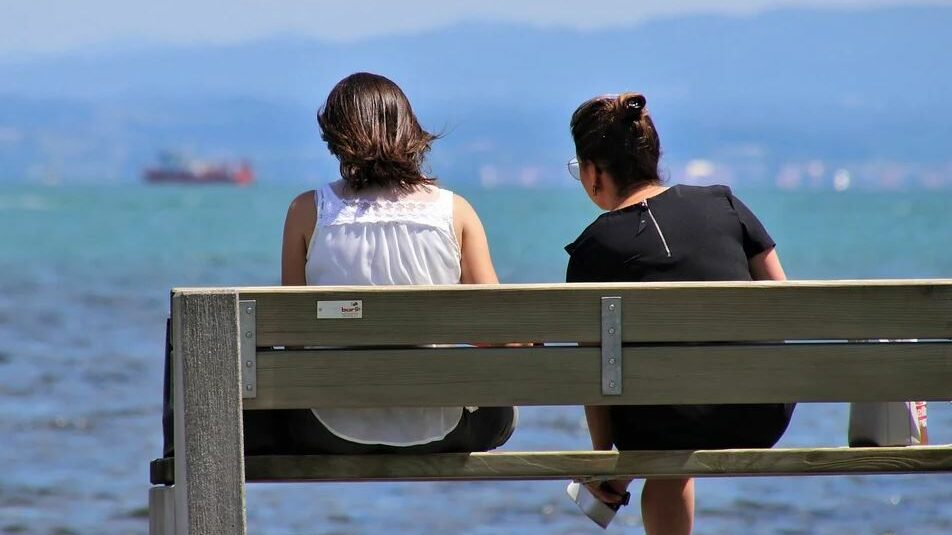 two girls on a bench